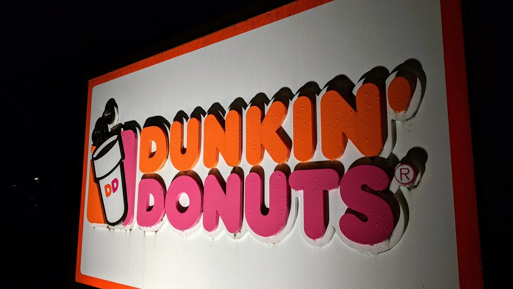 Dunkin/ Donuts logo featuring cup of coffee with steam coming out of the top