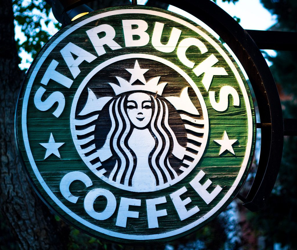 "Starbucks logo showing mermaid and the words ""Starbucks Coffee"""